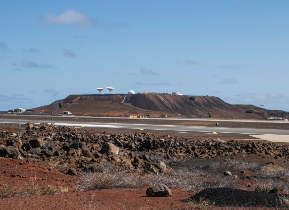 The USAF runway on Ascension Island that is a backup landing site for the US space shuttles with a large collection of USAF-NASA antennae on the plateau in the distance