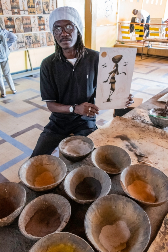 We stopped by an artists_ studio and gallery in Dakar, Senegal, where we learned about the local sand painting; this artist is holding the painting he created while he explained the se