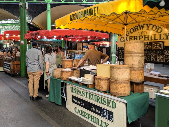 A cheese vendor selling Gorwydd Caerphilly cheese in Borough Market, London, England