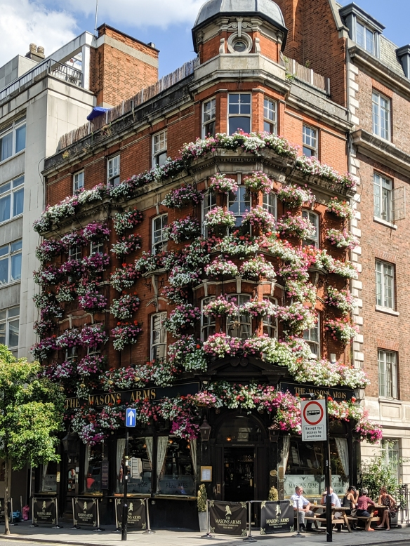A residential building beautifully adorned with flowers in Soho, City of Westminster, London, England
