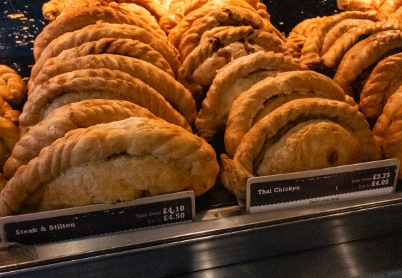 Freshly baked take-away Cornish pasties at The Cornish Bakery in Dartmouth, England; we bought several with some friends for lunch on the river boat to Totnes