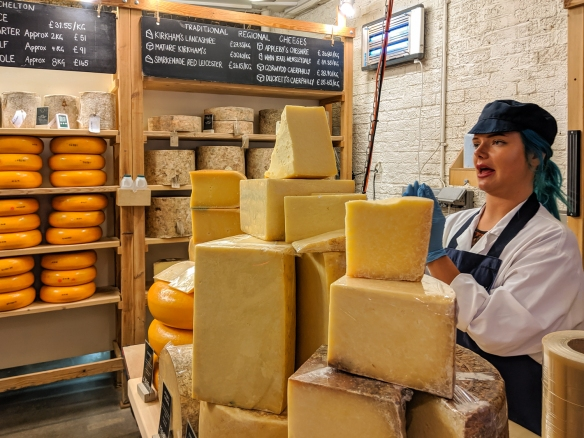 Just outside the stalls in Borough Market, London, England, is a permanent cheese store, one of several outposts of the famous Neal's Yard Dairy, where we bought a bagful of cheeses, fresh yoghurt and crème fraiche