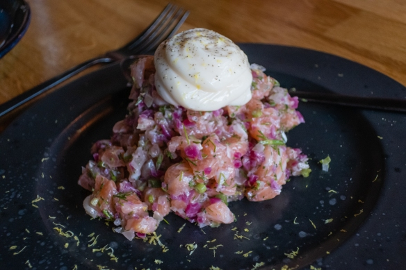 A first course of local salmon tartar with a delicious homemade mayonnaise topped with lemon peel and pepper, Frumbiti Restaurant, Tórshavn, Faroe Islands; this was our favorite starter