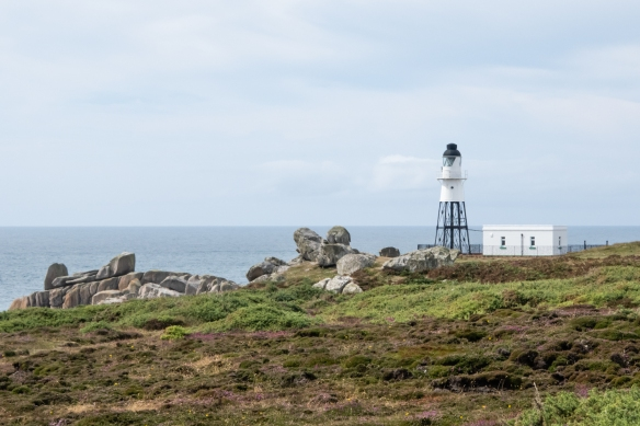 A lighthouse on the coast of St. Mary's Island, Isles of Scilly, England