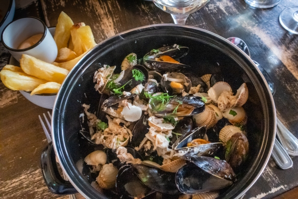 A main course of a pot of steamed local mussels, clams and crab meat served with chips (called French Fries in the US), The Winding Stair, Dublin, Republic of Ireland