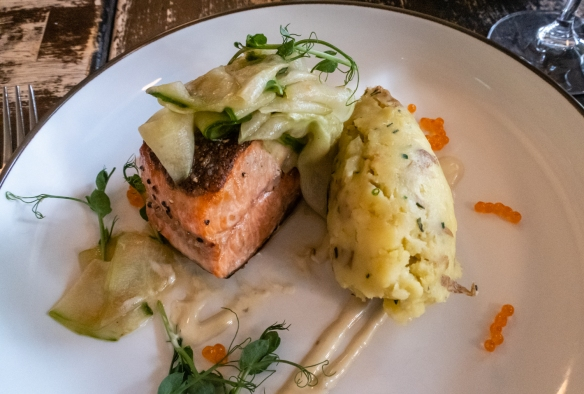 A main course of fresh, local salmon with roe and zucchini and mashed potatoes