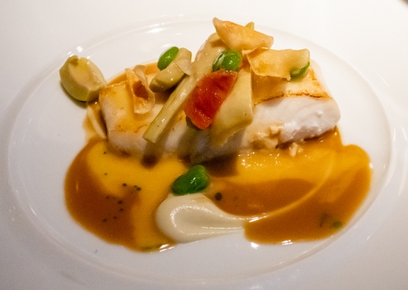 "A main course of Grilled Wild Halibut, Violet Artichoke Fricassé, Roasted Bone Jus, accompanied by 2014 Savigny-Les-Beaune ""Ez Connardises"", Domaine Françoise Andre , Restaurant Patrick Guilbaud, Dublin, Republic of Ireland"
