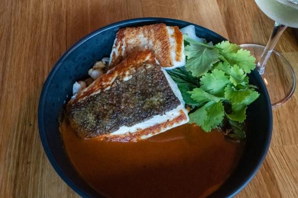 A main course of Reydsprøka, the local fish in a delicious sauce and a garbanzo bean salad underneath, Frumbiti Restaurant, Tórshavn, Faroe Islands
