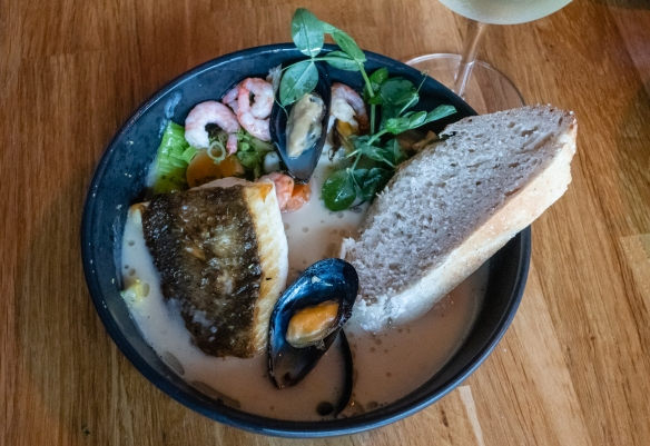 A main course of seafood chowder with a slice of homemade bread, Frumbiti Restaurant, Tórshavn, Faroe Islands; a nice array of local fish and shellfish in an excellent broth