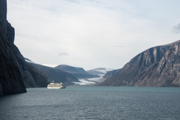A photograph of our ship in Sam Ford Fjord (Kangiqtualuk Uqquqti), taken from the helicopter as we flew further into the fjord, Baffin Island, Nunavut, Canada
