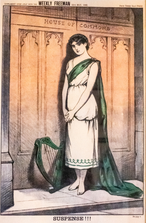 A second satirical cartoon caught our attention- Supplement given away with the WEEKLY FREEMAN 22nd May 1886 SUSPENSE!!! ERIN, the personification of IRELAND, stands outside the door of the House of Commons