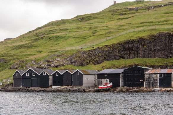 At the edge of Vestmanna Bay were a series of boat houses built some time ago for the local fishing boats, Vestmanna, Streymoy, Faroe Islands