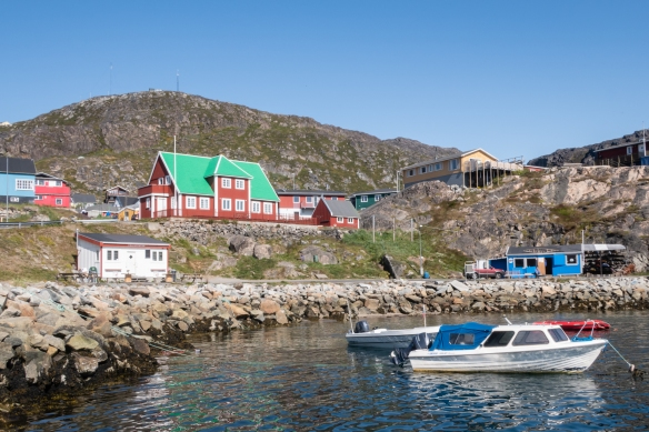 Homes along the waterfront, viewed from the pier at the harbor of Qaqortoq, southern Greenland's largest town (and the fourth largest in the country) and one of Greenland's most friendly and colorful settlements