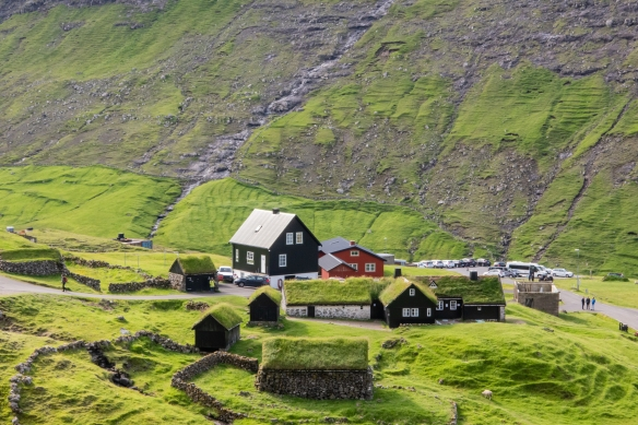 In the center of Saksun (population 14) is a 17th century Viking farmhouse (the left, white section of the long structure in the center of the photograph) called Dúvugarður, part of the Dúvugarður sheep farm