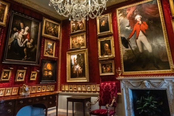 "In the Red Room the paintings appear as a ""cabinet hang"", typical of the type where many small, highly-decorative paintings are densely displayed – a cabinet was usually a private room in which intimate discussion took place"