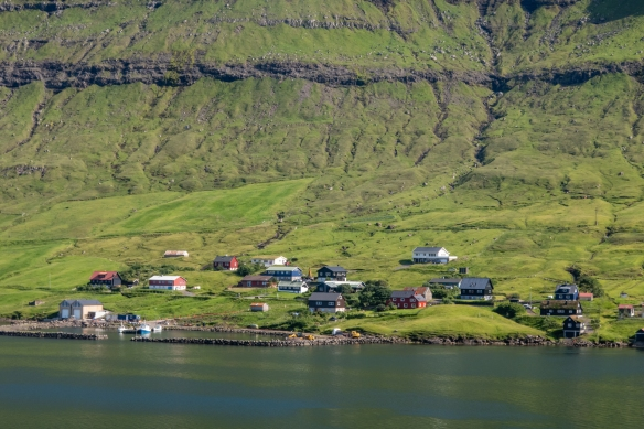 Note how the homes are along the shore of the fjord, not further up the mountains edging along the fjord, Kollafjørõur, Streymo, Faroe Islands