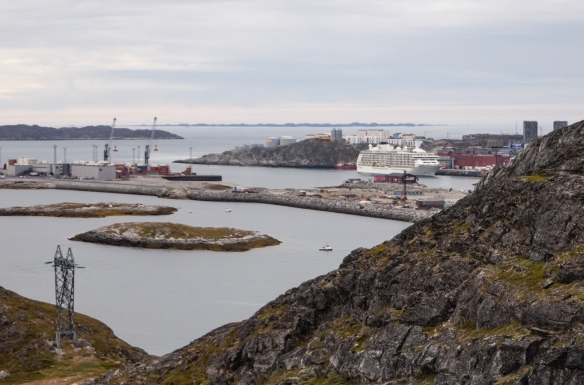 Our ship is visible in the main harbor-port of Nuuk, Geenland; note that outside of the main part of town, there is a new container port which is critical for commerce and supply in Greenland