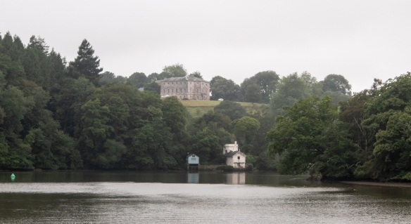 Seen on the hill (with the estate's boathouse on the River Dart (foreground)), the National Trust's Greenway House, Devon, is the holiday home of the famous and much-loved author Agatha Christie and her family
