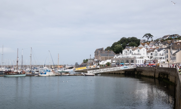 Several hotels and restaurants line the western quay of Brixham Harbor, Brixham, South Devon, England