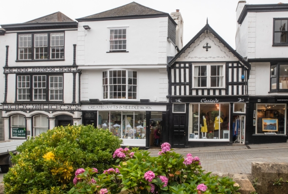 Shops along the street across from the Church of St. Mary the Virgin, Totnes, England