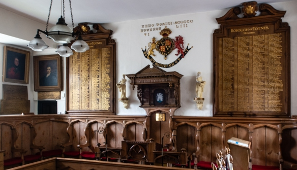 The atmospheric interior of the town's Guildhall that has been the home of the town council for over 450 years, Totnes, England