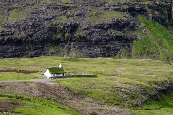 The church was set up in a spectacular setting, near the lagoon under the surrounding mountain, Saksun, Streymoy, Faroe Islands