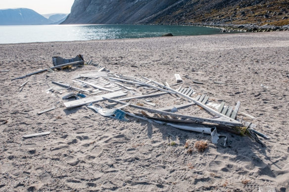"The remains of a large canoe that supported two outboard motors (indicating it was from the 20th century) on the beach at Feacham Bay, Buchan Gulf, Baffin Island, Canada; the ""carcass"" looks like a fish skeleton"