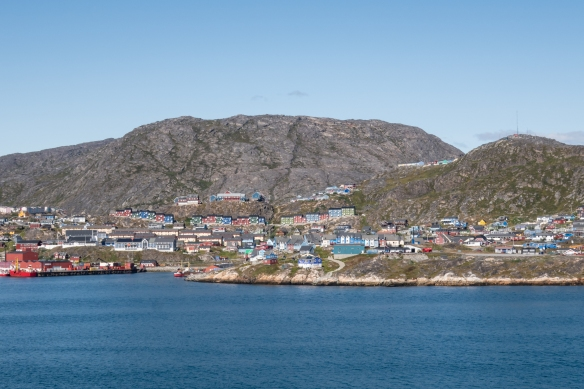 "The small harbor, ""downtown"" and residential neighborhoods of the coastal city, Qaqortoq, southern Greenland's largest town (and the fourth largest in the country) and one of Greenland's most friendly and colorful settlements"