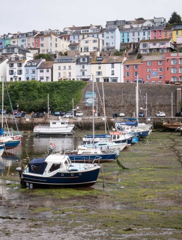 The tides in Brixham Harbor, Brixham, South Devon, England, run up to 20 feet (over 6 meters), so that at low tide many boats in the inner harbor are left sititing on the mud