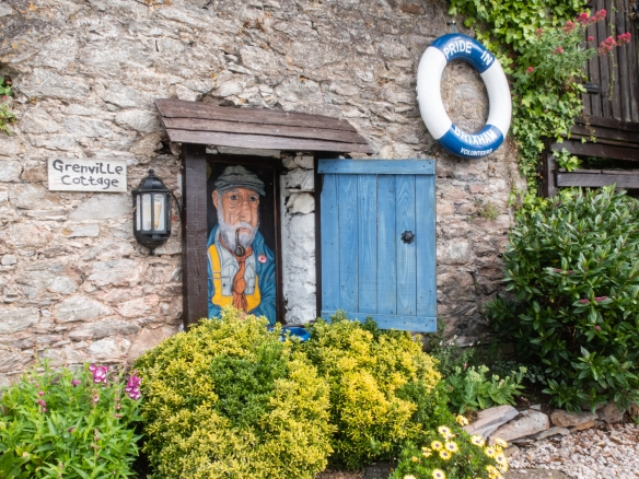 The whimsical entry to the Greenville Cottage on the western quay of Brixham Harbor, Brixham, South Devon, England