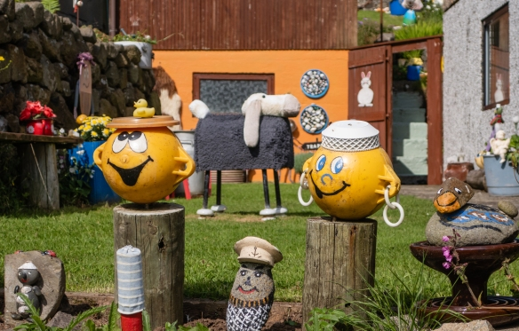 Whimsical figures hand made by a grandmother for her front yard for the delight of the town's children when walking by, Gjógv, Eysturoy, Faroe Islands