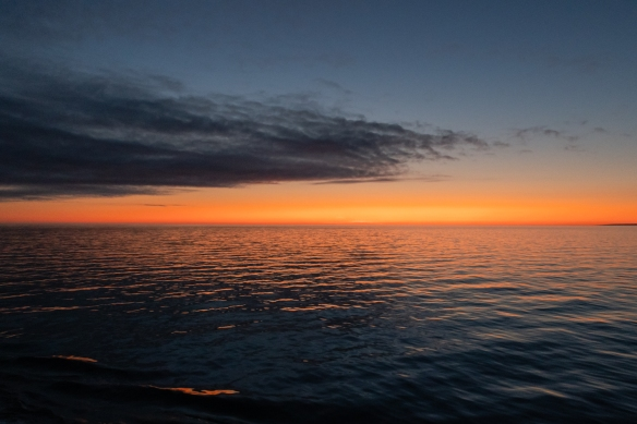 A beautiful sunset after we sailed out of Ulukhaktok, Victoria Island, Northwest Territories, Canada, on the way west to complete the Northwest Passage expedition – our final photograph in our Northwest Expedition blog posts