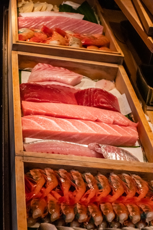 A broader view of the selection of fresh fish and seafood in the coolers at the preparation counter; Otomezushi, Kanazawa, Honshu Island, Japan