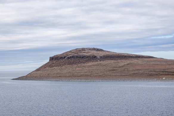A farewell photograph of the point of Ulukhaktok, Victoria Island, Northwest Territories, Canada, as we sailed into the Amundsen Gulf, heading west for our final four days of sailing to complete the NW Passage