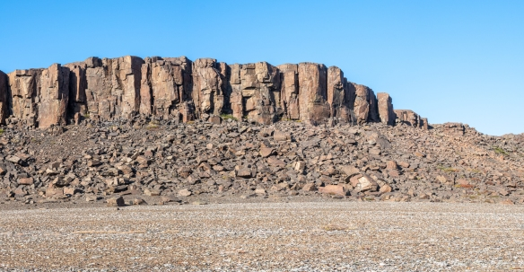 A panorama of a portion of the slowly eroding sedimentary rock outcropping, Port Epworth, mainland, Nunavut, Canada