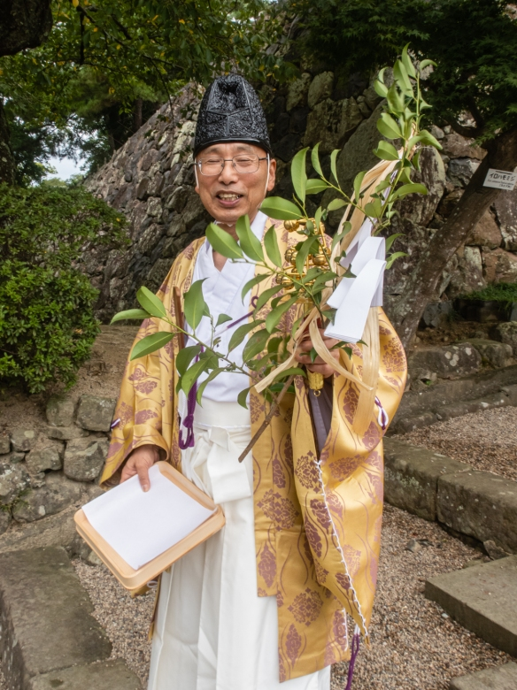 A priest coming down to the shrine adjacent to Matsue Castle, Matsue City, Shimane Prefecture on Honshu Island, Japan