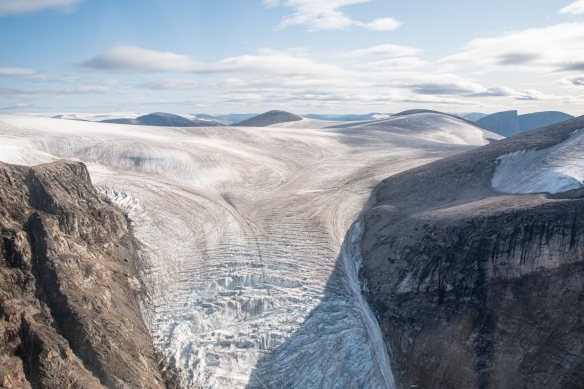 Aerial photo of Feacham Bay, Buchan Gulf, Baffin Island, Nunavut, Canada, #3 – this glacier is melting, but still hugging the mountains inland of the east coast of Baffin Island