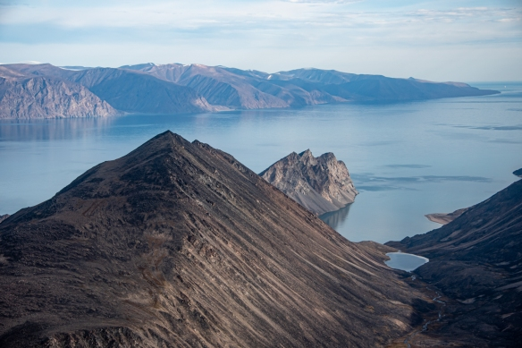 Aerial photo, Pond Inlet, Baffin Island, Nunavut, Canada, #3 – looking across the Baffin Island cliffs to Bylot Island (the southern tip of the island is visible on the far right in the background)