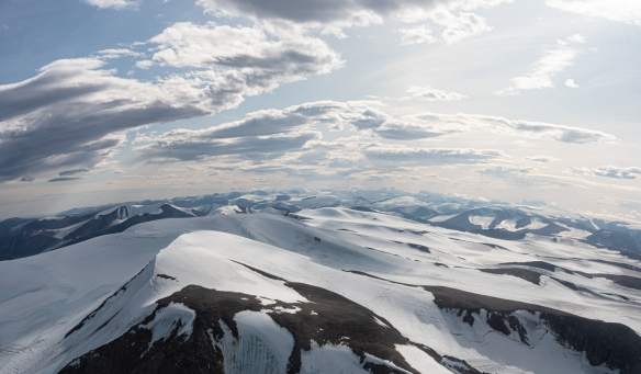 Aerial photo, Pond Inlet, Baffin Island, Nunavut, Canada, #5 – a two-photograph panorama of the Baffin Island interior glaciers; notice the curvature of the earth!