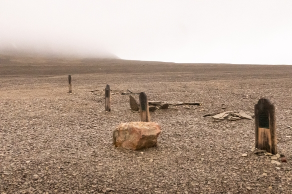 Another photograph of the graves of the three crew members of the Franklin expedition (towards the hills) and a fourth grave belonging to a searcher from an 1854 search expedition, Beechey Island (off the S.W. corner of Devon Island), Nunavut, Canada