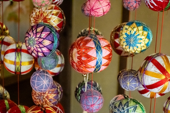"Beautiful colored Kaga Temari ""handballs"" suspended vertically to illustrate the skills of local women in designing and creating the traditional girls' handballs; Kanazawa Shinise Memorial Hall, Kanazawa, Honshu Island, Japan"