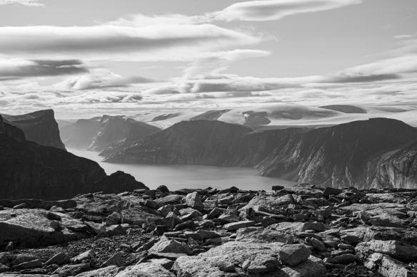 Cliff top photo of Feacham Bay, Buchan Gulf, Baffin Island, Nunavut, Canada, #5 – late afternoon sun illuminating the inland glaciers (black and white)