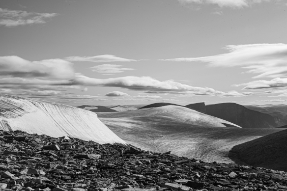 Cliff top photo of Feacham Bay, Buchan Gulf, Baffin Island, Nunavut, Canada, #7 – after turning my back to the fjord, a photograph made of the interior glaciers with the cliff top rocks in the foreground (black and white)