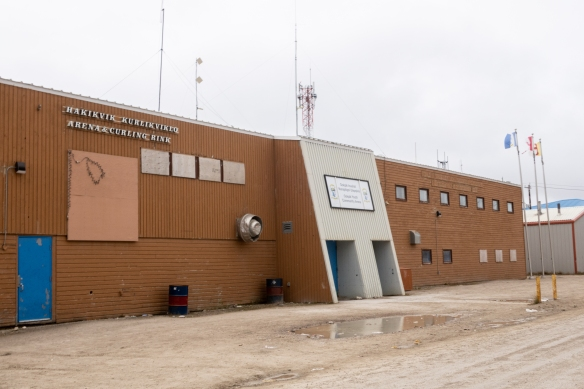 """Downtown"" Cambridge Bay has many large public facilities on the main street such as the arena and curling rink pictured here, along with the public health center, one of the two town grocery stores, and the town government offices"