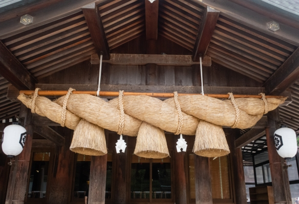 Izumo Taisha Shrine #7, Izumo Taisha, Shimane Prefecture on Honshu Island, Japan – a massive straw rope (shimenawa), 30 meters (99 feet) in length, the largest in Japan, hangs in front of Worship Hall