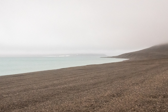 "Looking down to the ""beach"" of Beechey Island, the most notable historic site of the Northwest Passage exploration, as it was here that during the 1845-46 winter, Sir John Franklin's ships HMS Erebus and HMS Terror over-wintered"