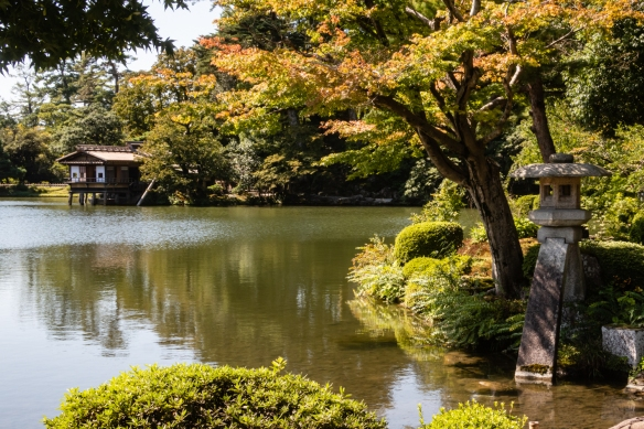 Looking past the Kotojitoto Lantern across Kasumigaike Pond in the center of Kenrokuen Garden, considered to be one of the three great gardens of Japan in Kanazawa, Honshu Island, Japan