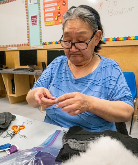 One of three elder Inuit women who graciously conducted a sewing demonstration and class for a small group of us in sewing the local winter mittens with rabbit fur trim at the Ulukhaktok Community Hall, Ulukhaktok, Victoria Island