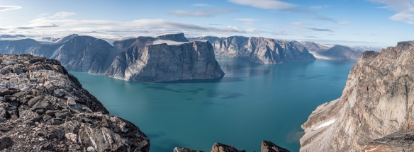 Panorama taken on a cliff top of Feacham Bay, Buchan Gulf, Baffin Island, Nunavut, Canada, #1 – notice the contrast between the dry, barren fjord cliffs and the snow and glaciers inland