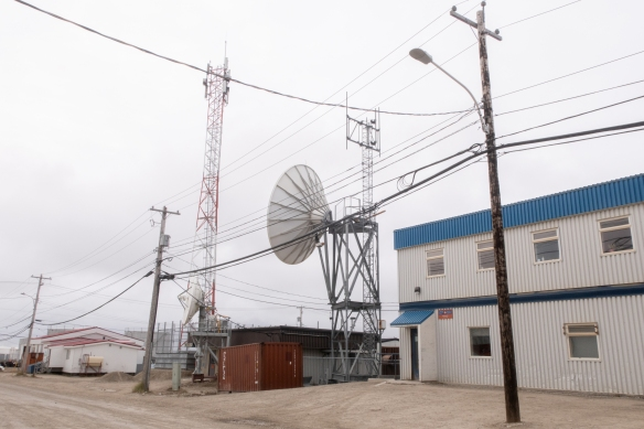 The Canadian communications company's office in town has quite a bit of modern equipment and antennae on the property, Cambridge Bay, Victoria Island, Nunavut, Canada